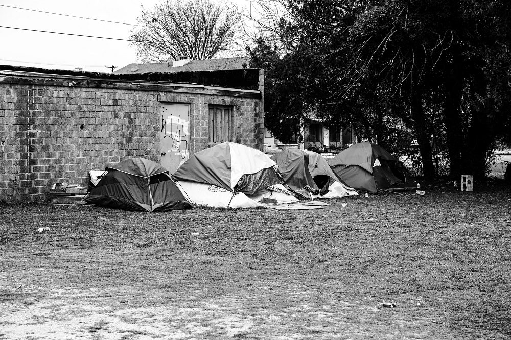 A small tent camp sits behind an empty Oklahoma City business on April 2, 2020. An outreach team dropped off meals to help feed the camp. [Credit: Nathan Poppe]