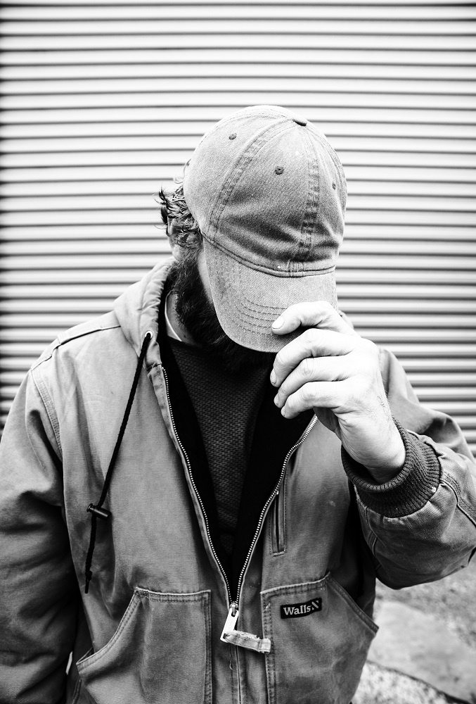 Nathan was willing to be interviewed but wasn't comfortable showing his face in a portrait. He said his struggle with addiction was complicated by COVID-19. [Credit: Nathan Poppe]