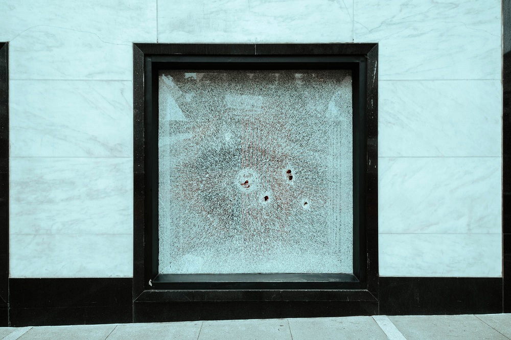 A broken window in Union Square. [Credit: Kit Castagne]