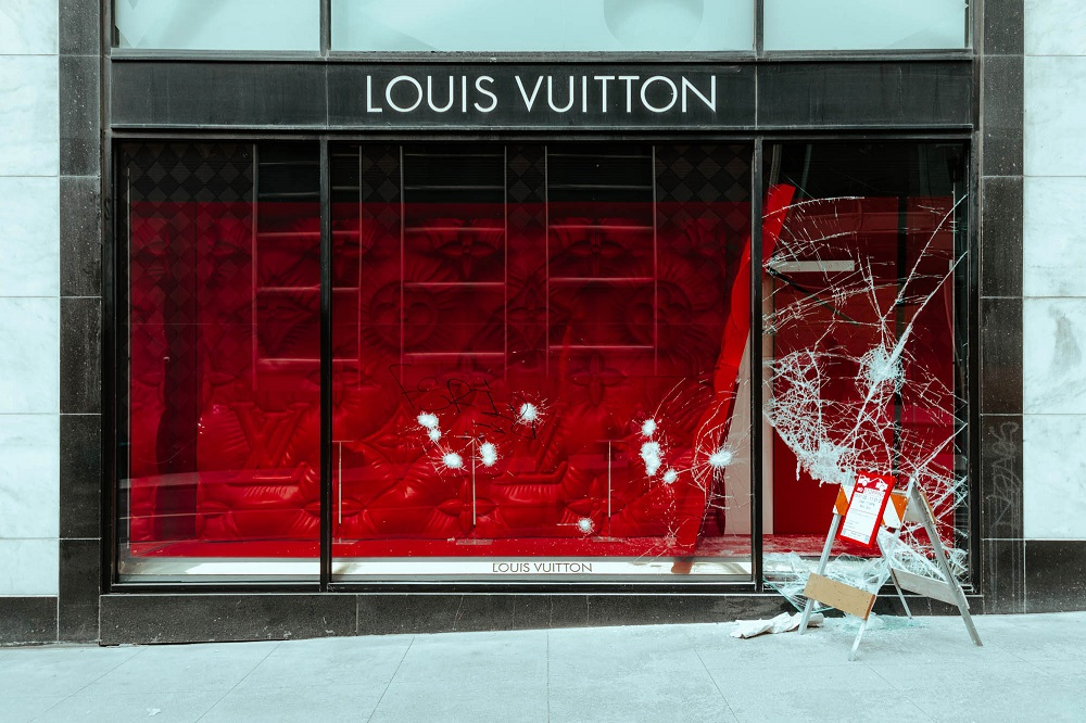 Broken windows at the Union Square Louis Vuitton store. [Credit: Kit Castagne]