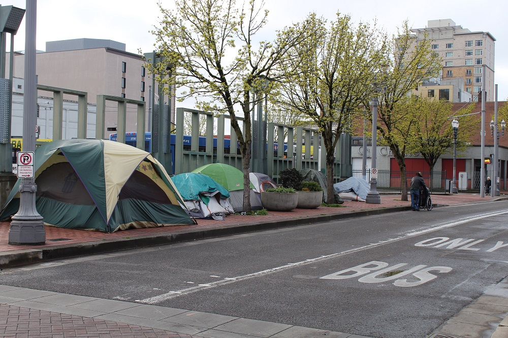 Tents line a sidewalk in Portland's Old Town. (Courtesy of Street Roots)