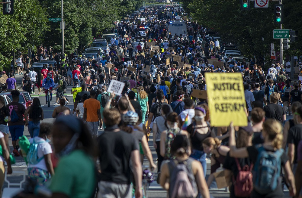 Protestors crowd 16th Street as they move toward the White House on June 6, 2020 in Washington, D.C. Photo courtesy of Cody Bahn / Street Sense
