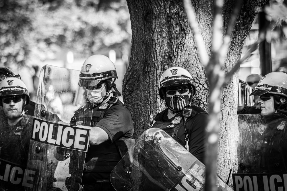 U.S. Park Police officers in riot gear form a line in Lafayette Square Park on Sunday, May 31. Photo by Benjamin Burgess.