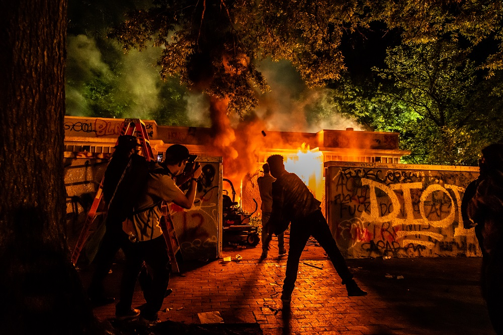 Someone set a public restroom in Lafayette Square Park on fire after the 11 p.m. curfew on Sunday, May 31. Photo by Benjamin Burgess.