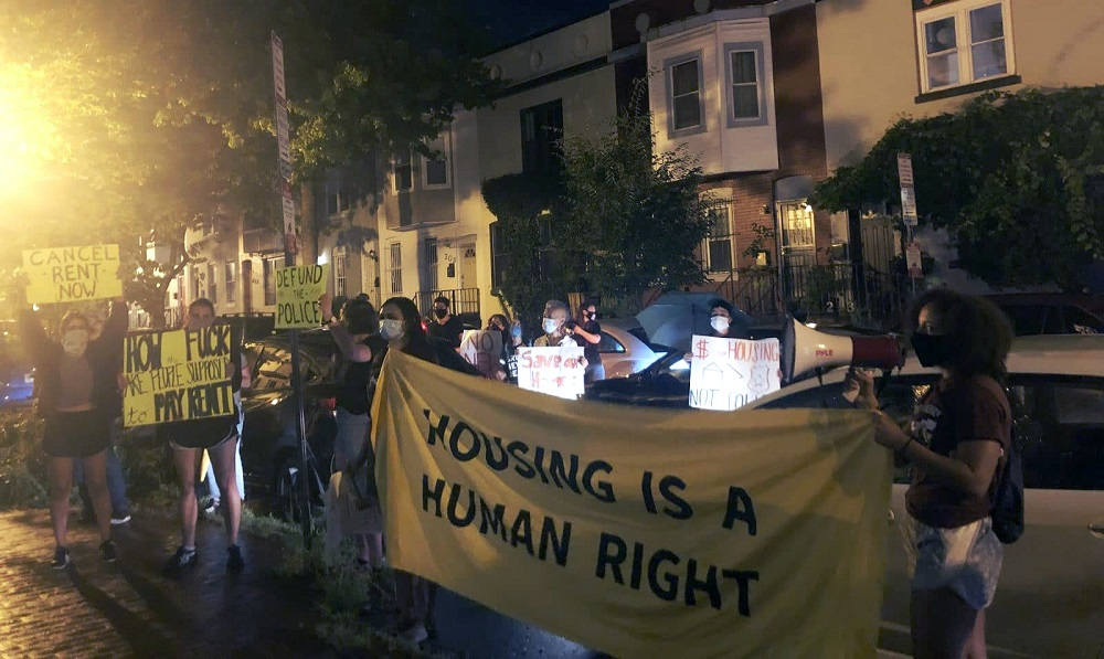 Protesters hold signs, chant, and make noise outside of Anita Bonds' home in D.C., on Tuesday, July 21, 2020. Anita Bonds is chair the D.C. Council Committee on Housing and Neighborhood Revitalization. Protestors called on her and the council to cancel rent for D.C. residents. Photo by Maria Trovato / Street Sense Media.