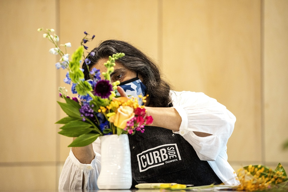 Sonya works on a bouquet on the opening day of Curbside Flowers. [Credit: Nathan Poppe, The Curbside Chronicle]