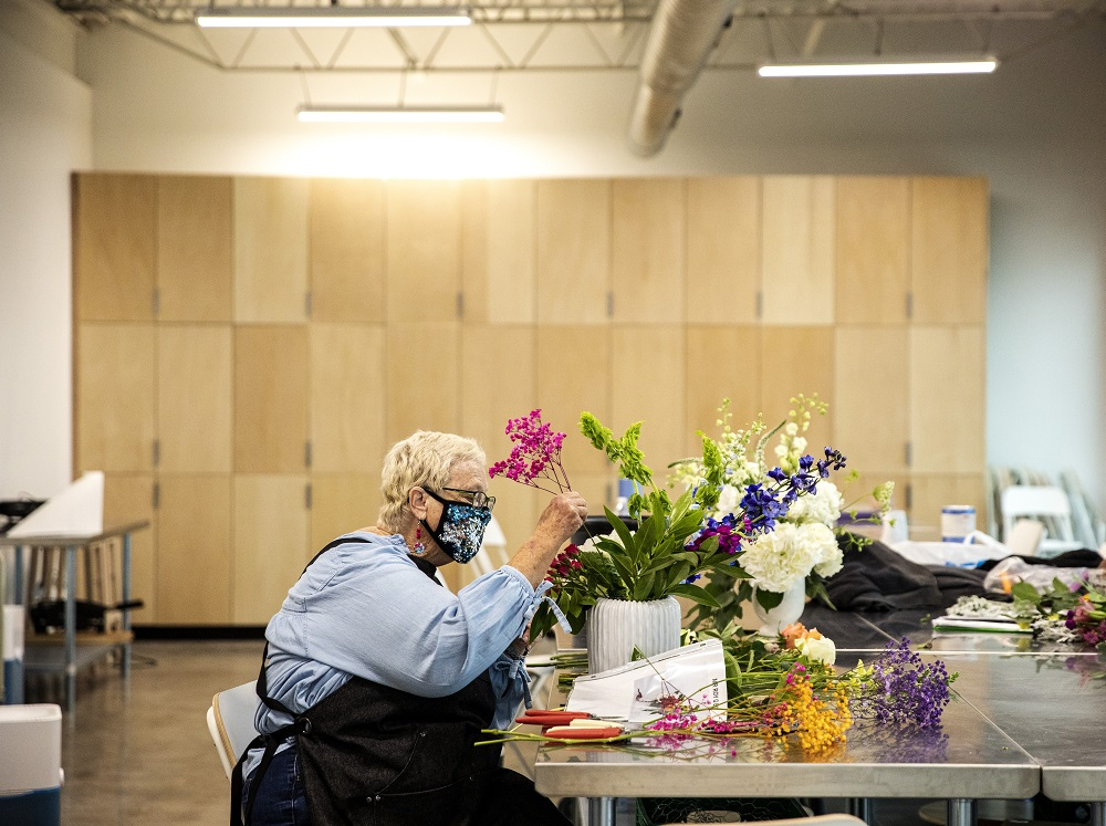 Marsha works on a bouquet on the opening day of Curbside Flowers. [Credit: Nathan Poppe, The Curbside Chronicle]