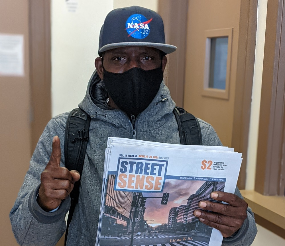 Street Sense vendor Ron 'Pookabu' Dudley, who interviewed the Chuck D and Tom Morello featuring rock/rap supergroup Prophets of Rage for the street paper network in 2016. [Credit: Doris Warrell]