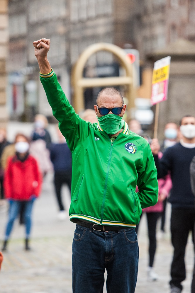People participating in the 'Take a Knee for George' demonstration, outside St Giles Cathedral in Edinburgh. The demonstration was organised by Stand Up To Racism. Credit: Wullie Marr Photography